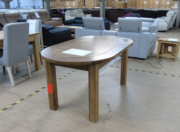 Solid dark oak extending dining table £249 (SWANSEA SUPERSTORE)