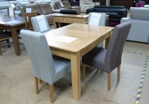 Medium oak extending dining table and 4 chairs £448 (SWANSEA SUPERSTORE)