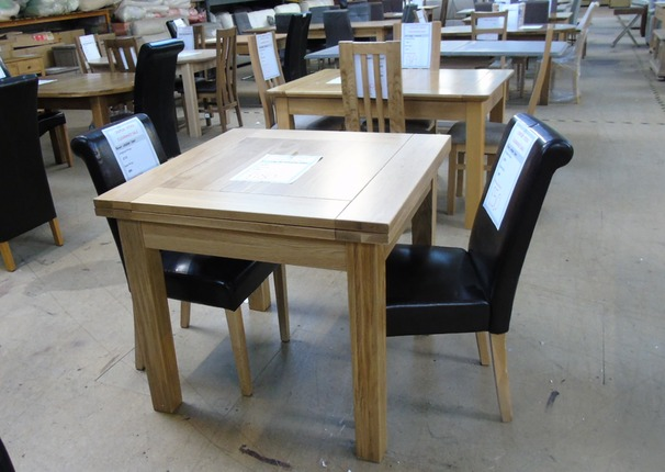 Medium oak dining table and 2 chairs £279 (SWANSEA SUPERSTORE)