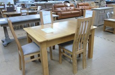 Medium Oak dining table and four chairs £449 (SWANSEA SUPERSTORE) - Click for more details