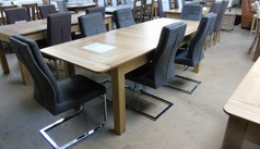 Large extending table and six chairs £499 (SWANSEA SUPERSTORE) - Click for more details